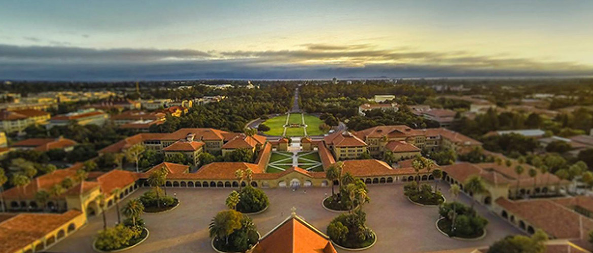Aerial view of Stanford campus oval with surrounding buildings