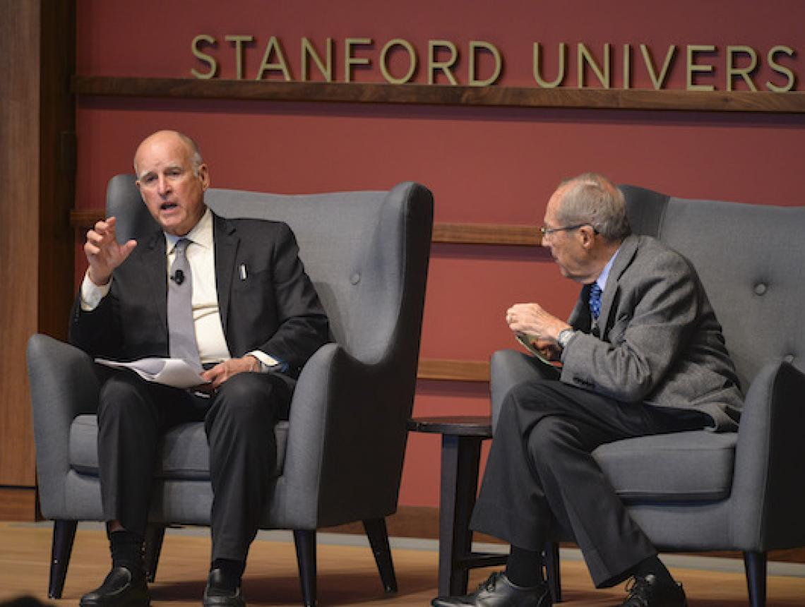 Former Governor of California Jerry Brown in conversation with former U.S. Defense Secretary William Perry (right)