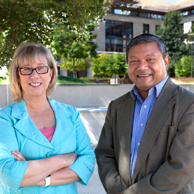 Sally Benson and Arun Majumdar in the courtyard of the Stanford Engineering Quad.